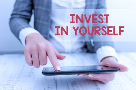 Word writing text Invest In Yourself. Business photo showcasing learn new things or materials thus making your lot better Business concept with mobile phone in the hand