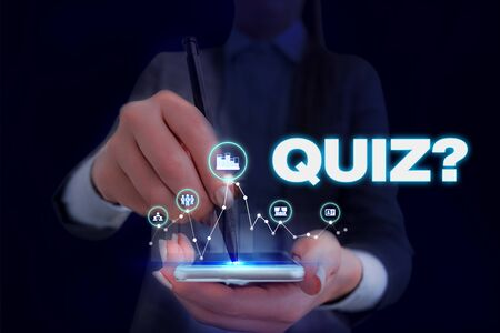 Writing note showing Quiz Question. Business concept for test of knowledge as competition between individuals or teams Woman wear formal work suit presenting presentation using smart device Stock fotó