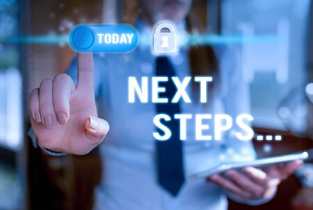 Writing note showing Next Steps. Business concept for something you do after you have finished doing first one Modern technology Lady front presenting hands blue glow copy space Фото со стока