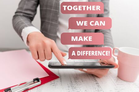 Text sign showing Together We Can Make A Difference. Business photo text be very important some way in like team or group Business concept with mobile phone in the hand