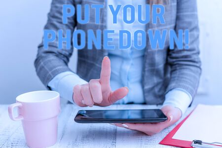 Conceptual hand writing showing Put Your Phone Down. Concept meaning end telephone connection saying goodbye caller Business woman sitting with mobile phone and cup of coffee
