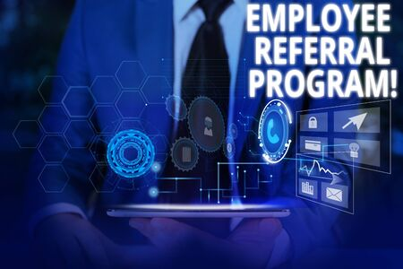 Writing note showing Employee Referral Program. Business concept for internal recruitment method employed by organizations Male wear formal suit presenting presentation smart device Foto de archivo