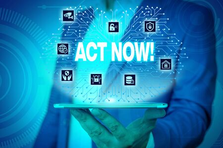 Text sign showing Act Now. Business photo text do not hesitate and start working or doing stuff right away Male human wear formal work suit presenting presentation using smart device 스톡 콘텐츠
