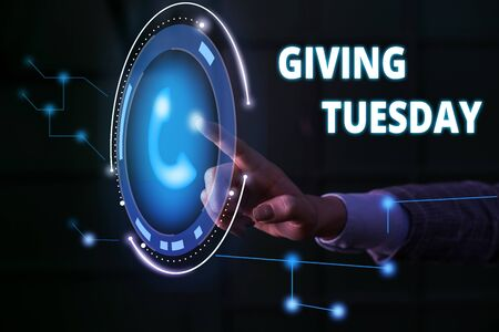 Handwriting text Giving Tuesday. Conceptual photo international day of charitable giving Hashtag activism Lady presenting hand blue glow futuristic modern technology tech look contact Reklamní fotografie