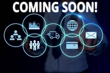 Text sign showing Coming Soon. Business photo text event or action that will happen after really short time Woman wear formal work suit presenting presentation using smart device