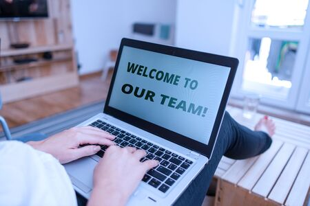 Word writing text Welcome To Our Team. Business photo showcasing introducing another demonstrating to your team mates woman laptop computer office supplies technological devices inside home Reklamní fotografie - 131344403
