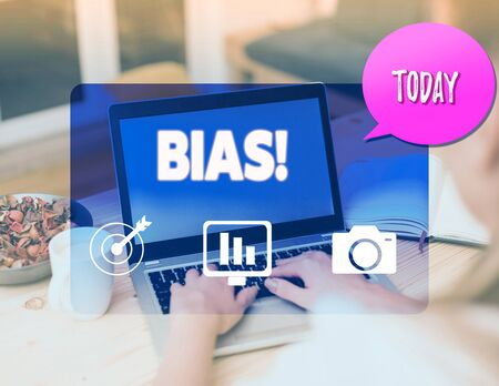 Writing note showing Bias. Business concept for inclination or prejudice for or against one demonstrating group