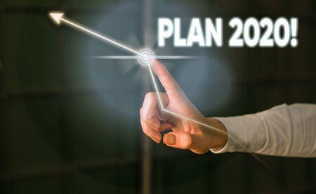 Conceptual hand writing showing Plan 2020. Concept meaning detailed proposal for doing or achieving something next year Lady front presenting hand blue futuristic modern technology