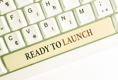 Writing note showing Ready To Launch. Business concept for an event to celebrate or introduce something new to market White pc keyboard with note paper above the white background