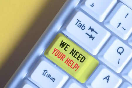 Word writing text We Need Your Help. Business photo showcasing asking someone to stand with you against difficulty White pc keyboard with empty note paper above white background key copy space