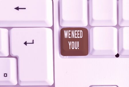 Writing note showing We Need You. Business concept for asking someone to work together for certain job or target White pc keyboard with note paper above the white background Stock fotó