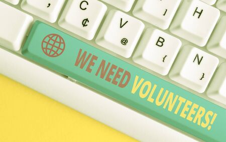 Conceptual hand writing showing We Need Volunteers. Concept meaning someone who does work without being paid for it White pc keyboard with note paper above the white background Banco de Imagens