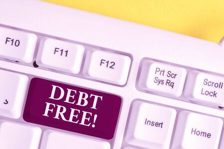 Handwriting text writing Debt Free. Conceptual photo does not owning any money or things to any individual or companies White pc keyboard with empty note paper above white background key copy space