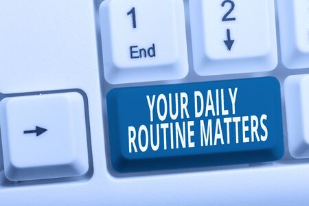 Writing note showing Your Daily Routine Matters. Business concept for practice of regularly doing things in fixed order White pc keyboard with note paper above the white background