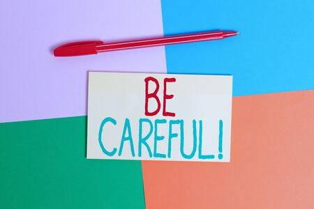 Conceptual hand writing showing Be Careful. Concept meaning making sure of avoiding potential danger mishap or harm Office appliance square desk study supplies paper sticker