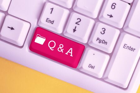 Conceptual hand writing showing Q And A Question. Concept meaning in which demonstrating asks questions and another one answers them White pc keyboard with note paper above the white background