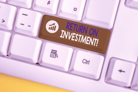 Conceptual hand writing showing Return On Investment. Concept meaning perforanalysisce measure used evaluate efficiency of investment White pc keyboard with note paper above the white background