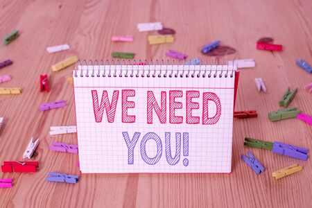 Handwriting text writing We Need You. Conceptual photo asking someone to work together for certain job or target Colored clothespin papers empty reminder wooden floor background office