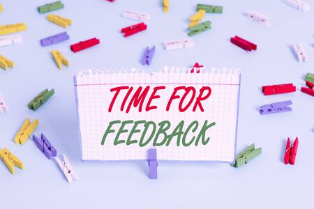 Text sign showing Time For Feedback. Business photo showcasing information about reactions to a product or services Colored clothespin papers empty reminder blue floor background office pin