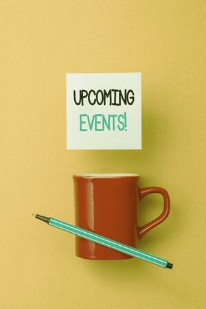 Writing note showing Upcoming Events. Business concept for thing that will happens or takes place soon planned occasion Front view coffee cup colored sticky note pen yolk color background