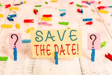 Writing note showing Save The Date. Business concept for remember not schedule anything else on this day Crumbling sheet with paper clips placed on the wooden table Stockfoto