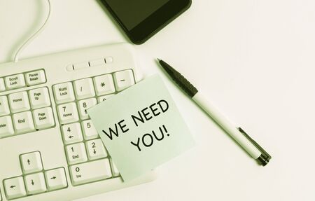 Handwriting text writing We Need You. Conceptual photo asking someone to work together for certain job or target White pc keyboard with empty note paper above white background