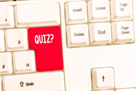 Word writing text Quiz Question. Business photo showcasing test of knowledge as competition between individuals or teams White pc keyboard with empty note paper above white background key copy space Stock fotó - 129362478