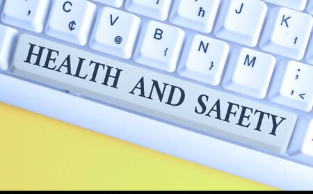 Handwriting text writing Health And Safety question. Conceptual photo regulations and procedures intended to prevent accident White pc keyboard with empty note paper above white background key copy space