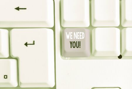 Text sign showing We Need You. Business photo showcasing asking someone to work together for certain job or target White pc keyboard with empty note paper above white background key copy space