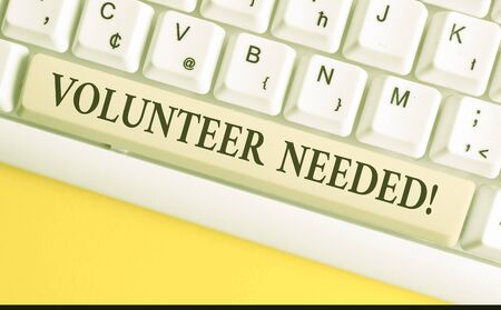Handwriting text writing Volunteer Needed. Conceptual photo need work for organization without being paid White pc keyboard with empty note paper above white background key copy space