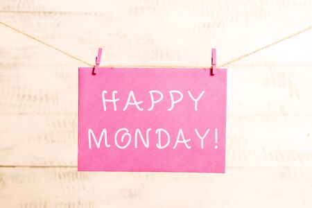 Word writing text Happy Monday. Business photo showcasing telling that demonstrating order to wish him great new week Clothesline clothespin rectangle shaped paper reminder white wood desk