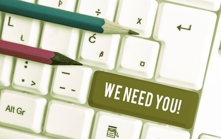 Conceptual hand writing showing We Need You. Concept meaning asking someone to work together for certain job or target White pc keyboard with note paper above the white background Stock fotó