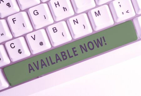 Text sign showing Available Now. Business photo showcasing you can find it obtain or operable at this current moment White pc keyboard with empty note paper above white background key copy space Foto de archivo - 129371975