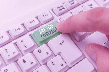 Word writing text Are You Covered Question. Business photo showcasing asking showing if they had insurance in work or life White pc keyboard with empty note paper above white background key copy space Stock Photo