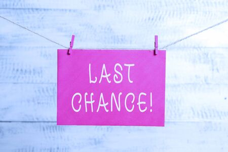 Word writing text Last Chance. Business photo showcasing final opportunity to achieve or acquire something you want Clothesline clothespin rectangle shaped paper reminder white wood desk