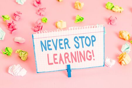 Text sign showing Never Stop Learning. Business photo showcasing keep on studying gaining new knowledge or materials Banco de Imagens