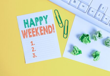 Conceptual hand writing showing Happy Weekend. Concept meaning something nice has happened or they feel satisfied with life Flat lay with copy space white paper with paper clips on the table Standard-Bild - 129373833