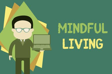 Text sign showing Mindful Living. Business photo text Fully aware and engaged on something Conscious and Sensible Standing man in suit wearing eyeglasses holding open laptop photo Art