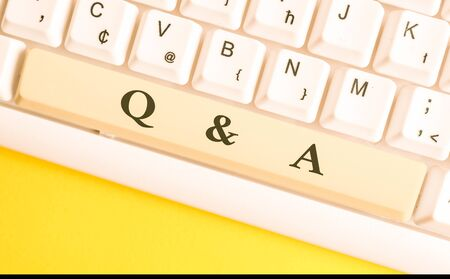 Handwriting text writing Q And A. Conceptual photo defined as questions being asked and answers White pc keyboard with empty note paper above white background key copy space