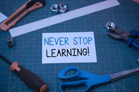 Handwriting text Never Stop Learning. Conceptual photo keep on studying gaining new knowledge or materials Carpentry equipments and plain paper scattered everywhere on measuring mat