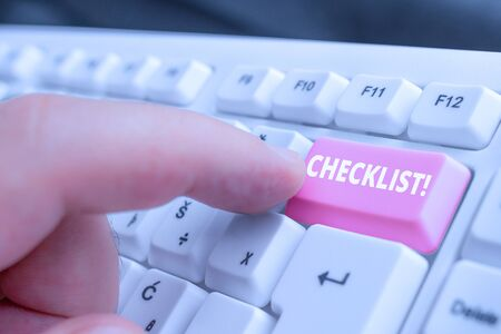Writing note showing Checklist. Business concept for list items required things be done or points considered White pc keyboard with note paper above the white background