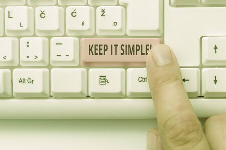 Text sign showing Keep It Simple. Business photo showcasing ask something easy understand not go into too much detail White pc keyboard with empty note paper above white background key copy space