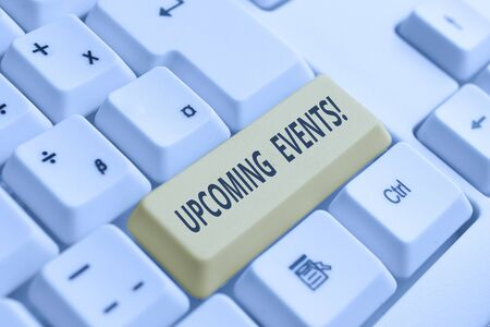 Conceptual hand writing showing Upcoming Events. Concept meaning thing that will happens or takes place soon planned occasion White pc keyboard with note paper above the white background
