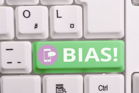 Writing note showing Bias. Business concept for inclination or prejudice for or against one demonstrating group Keyboard with note paper on white background key copy space