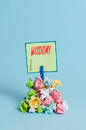 Conceptual hand writing showing Wisdom. Concept meaning the ability to use your knowledge and experience to make decisions Reminder pile colored crumpled paper clothespin wooden space Stock fotó