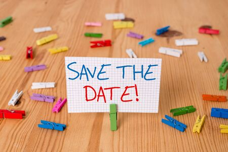 Text sign showing Save The Date. Business photo text Organizing events well make day special event organizers Colored clothespin papers empty reminder wooden floor background office Stockfoto