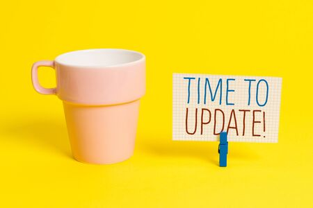 Word writing text Time To Update. Business photo showcasing act updating something someone or updated version program Cup empty paper blue clothespin rectangle shaped reminder yellow office