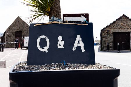 Text sign showing Q And A. Business photo showcasing defined as questions being asked and answers Empty black board with copy space for advertising. Blank dark board Stock fotó - 129375887