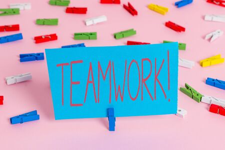 Writing note showing Teamwork. Business concept for combined action of group especially when effective and efficient Colored clothespin papers empty reminder pink floor office pin