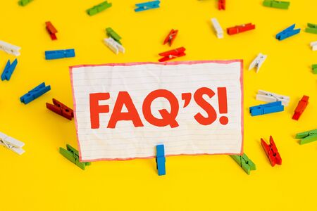 Conceptual hand writing showing Faq S. Concept meaning list of questions and answers relating to particular subject Colored clothespin papers empty reminder yellow floor office